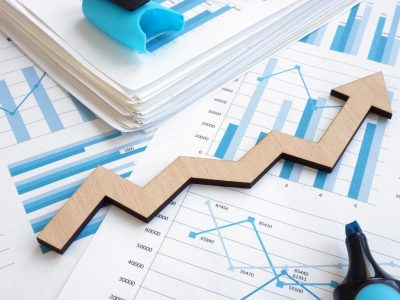 Business growth concept. Financial report with graphs and arrow.